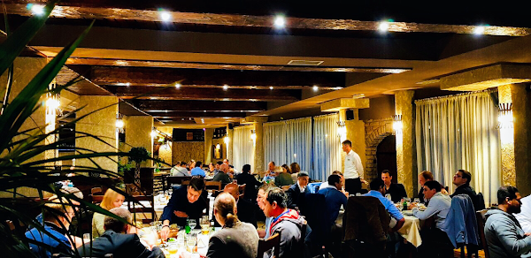 This is a picture of people eating in the Olimpija restaurant in Montenegro.